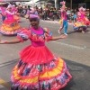 Colombian woman dances past in Carnival in Barranquilla, Bogota